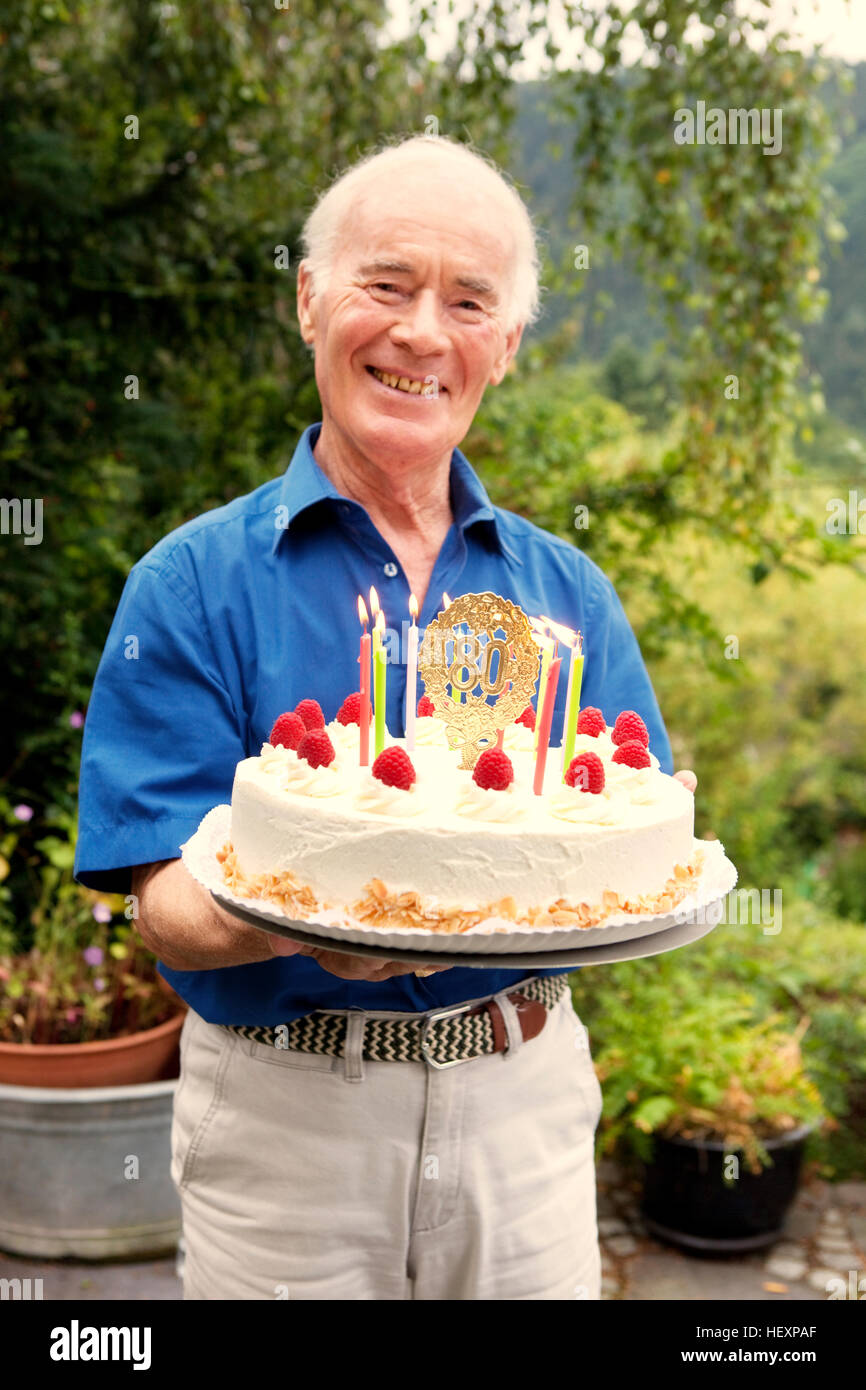 Senior Man Holding 80th Birthday Cake Stock Photo 129666055 Alamy