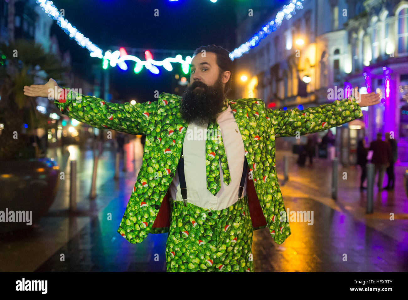 A reveller with a sprout suit on St. Mary's Street during Black Friday in Cardiff, South Wales. - Stock Image
