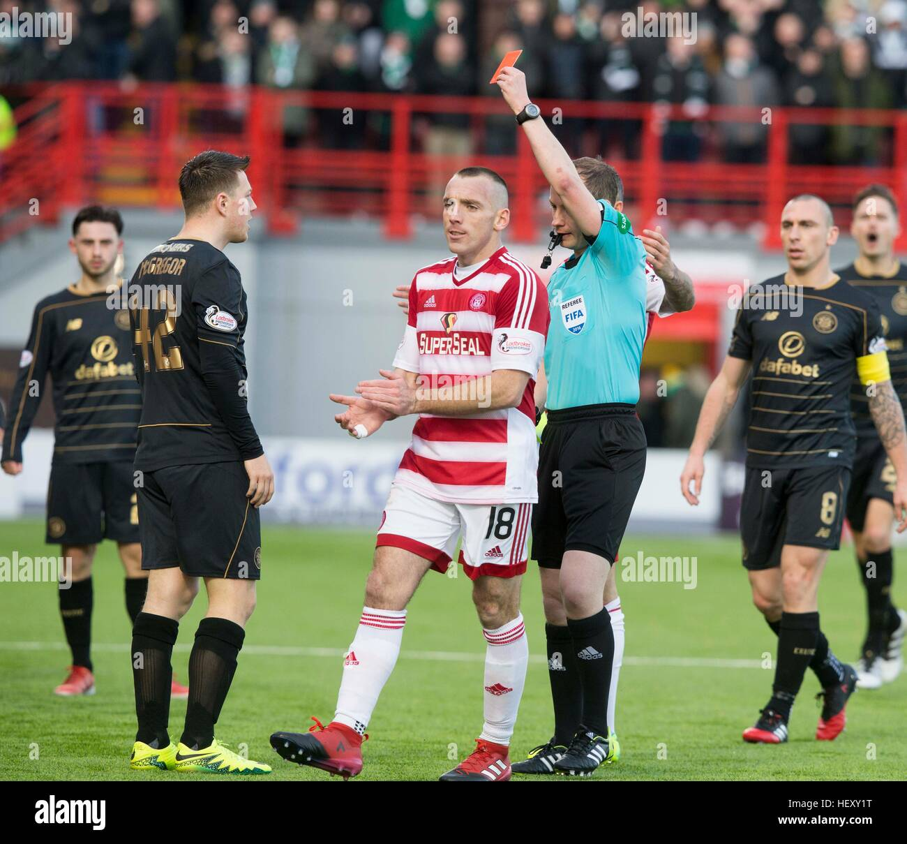 Celtic's Callum McGregor receives a red card during the Ladbrokes Scottish Premiership match at New Douglas - Stock Image