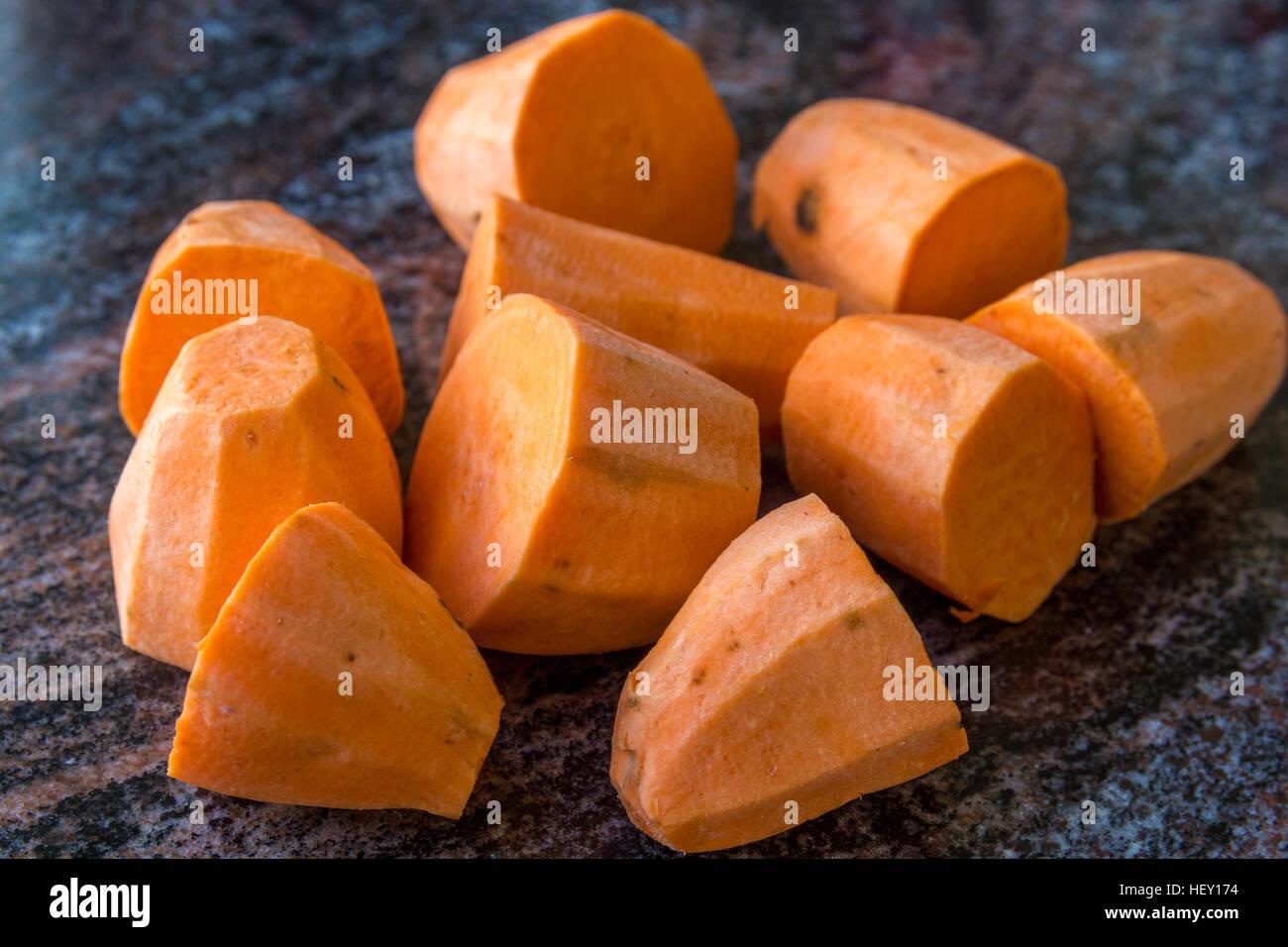pieces of chopped sweet potato - Stock Image