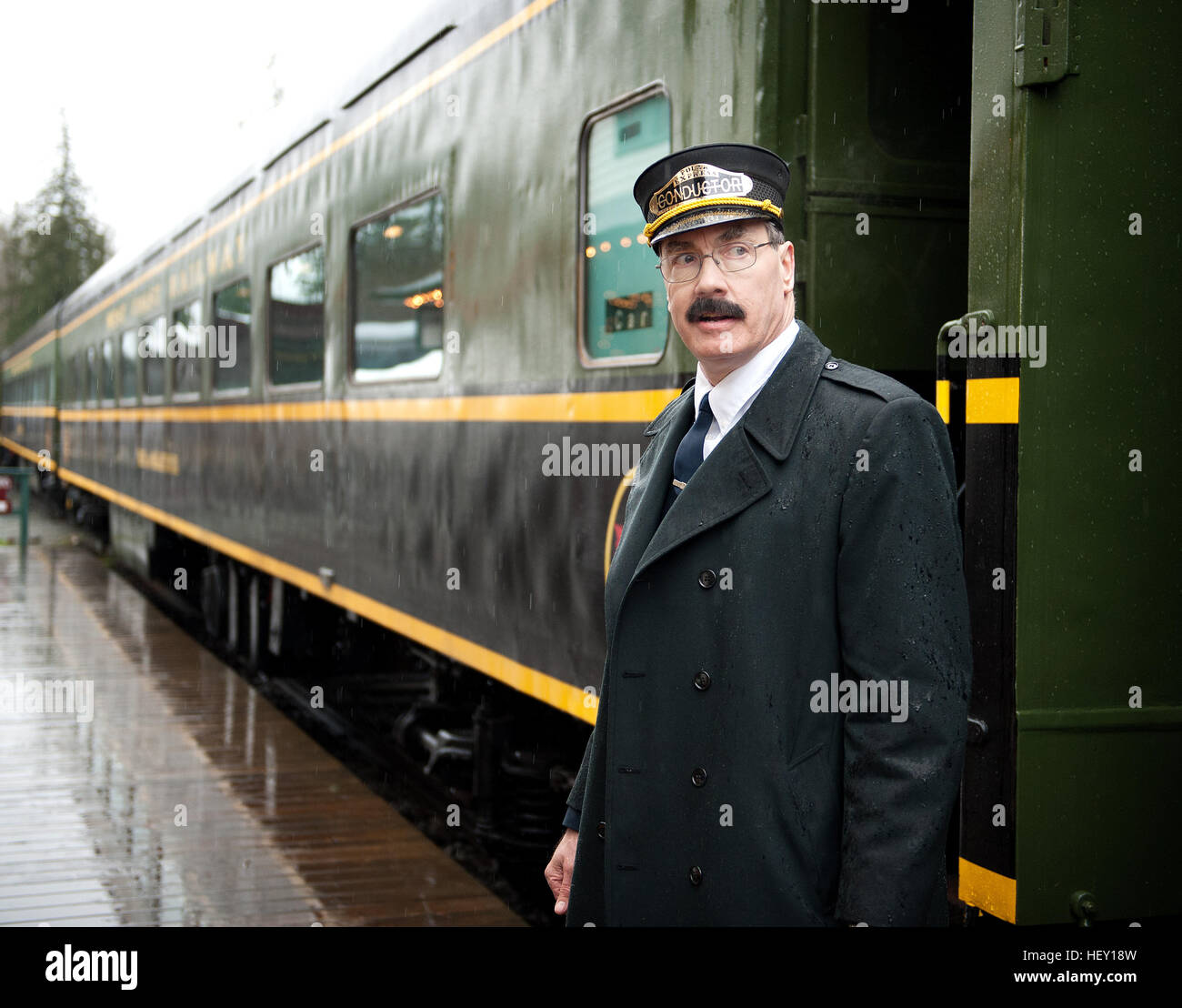 Polar Express Christmas train ride conductor Rob Payette at the West Coast Railway Park.  Squamish BC, Canada - Stock Image