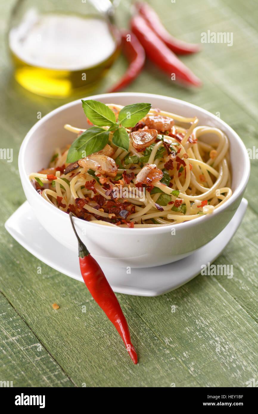 Spaghetti with garlic, oil and hot pepper - traditional Italian recipe - Stock Image