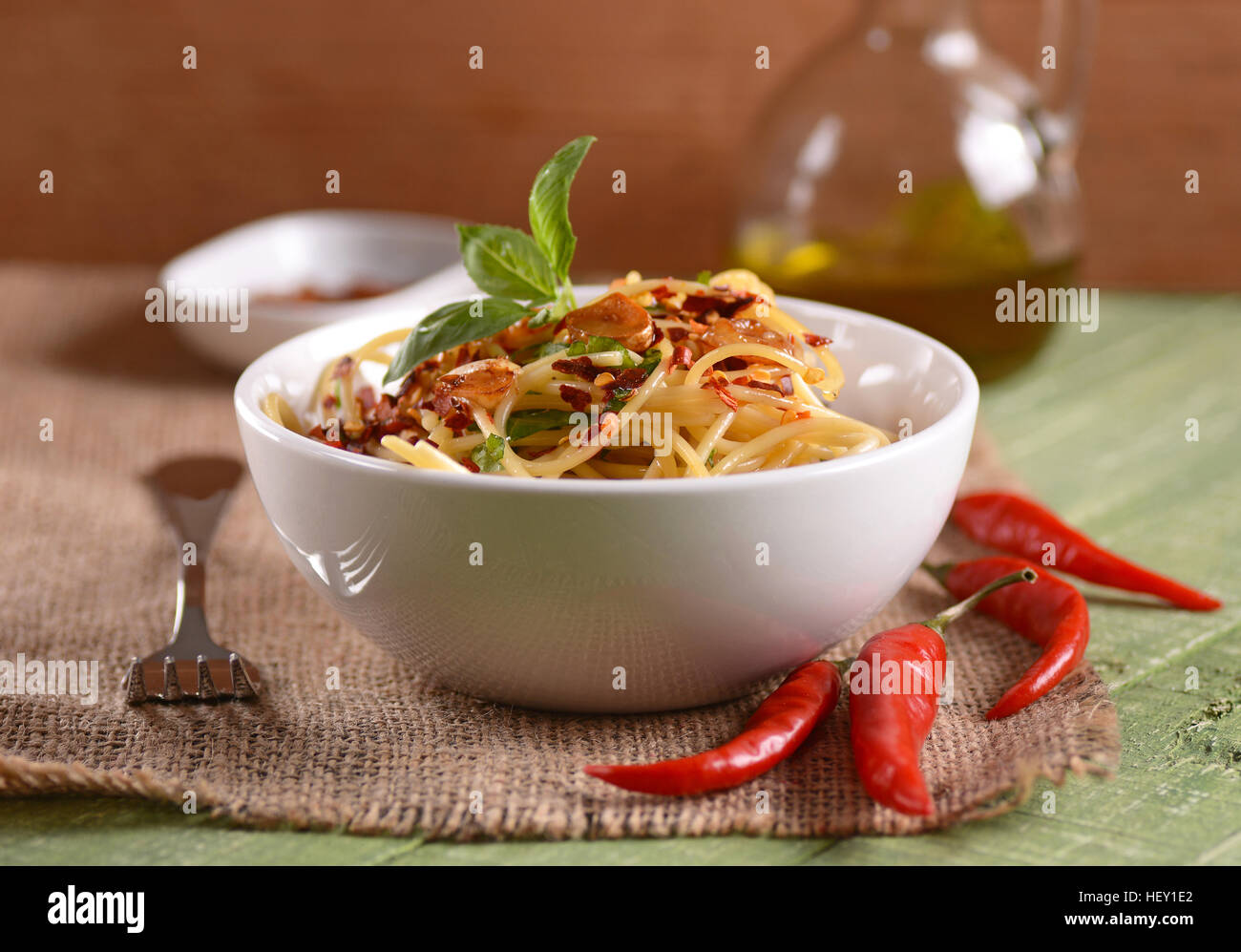 Spaghetti with garlic, oil and hot pepper - traditional Italian recipe - Stock Image