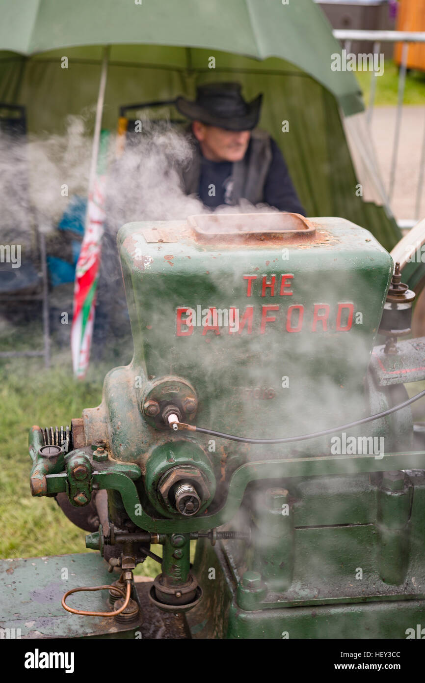 A vintage Stationary Engine, The Bamford, with its owner at a county show. Stock Photo