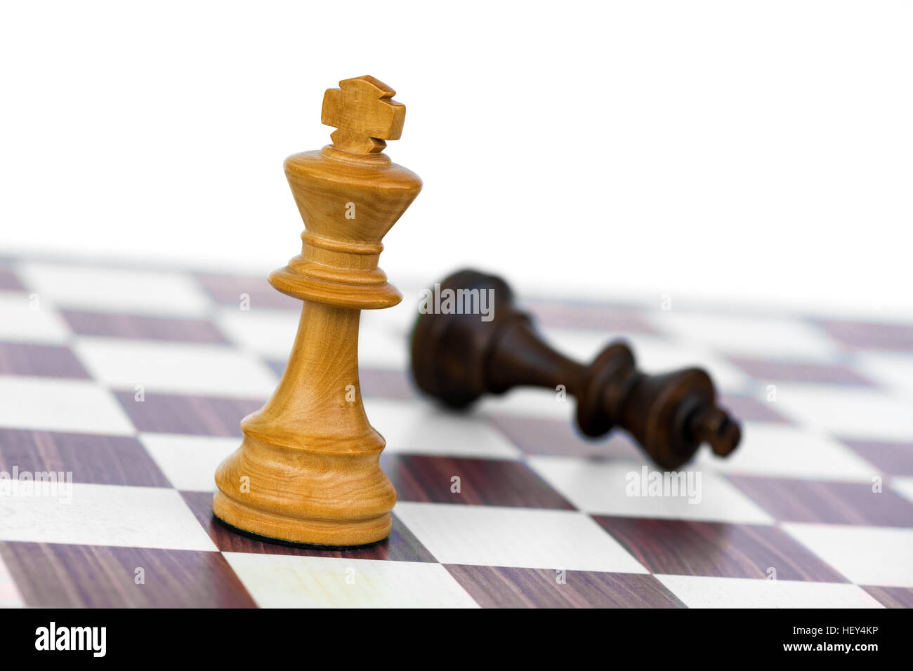 white chess king check black on chessboard - Stock Image