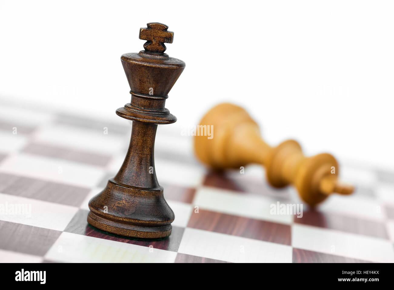black chess king check white on chessboard - Stock Image