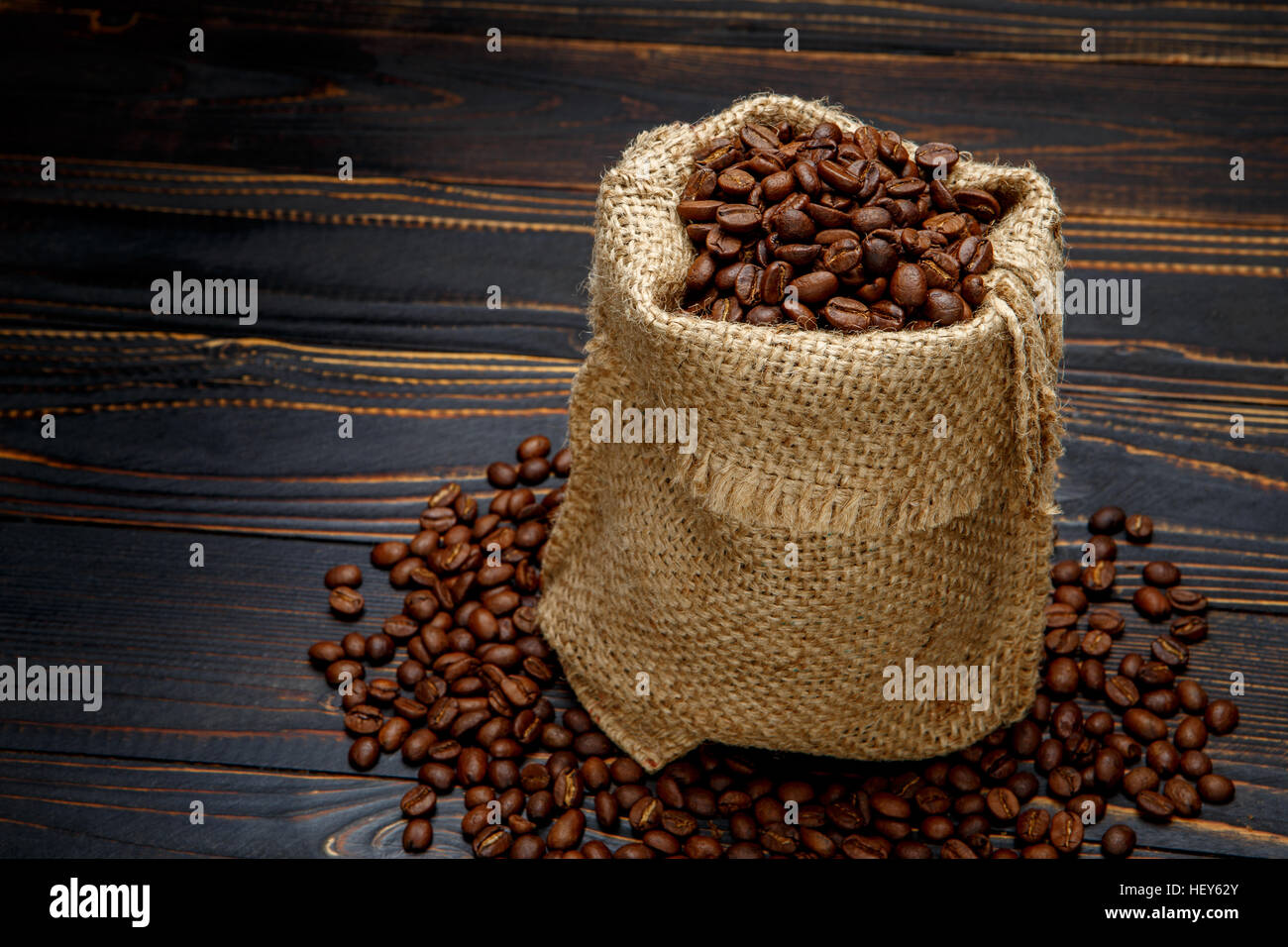 roasted coffee beans on wooden background - Stock Image