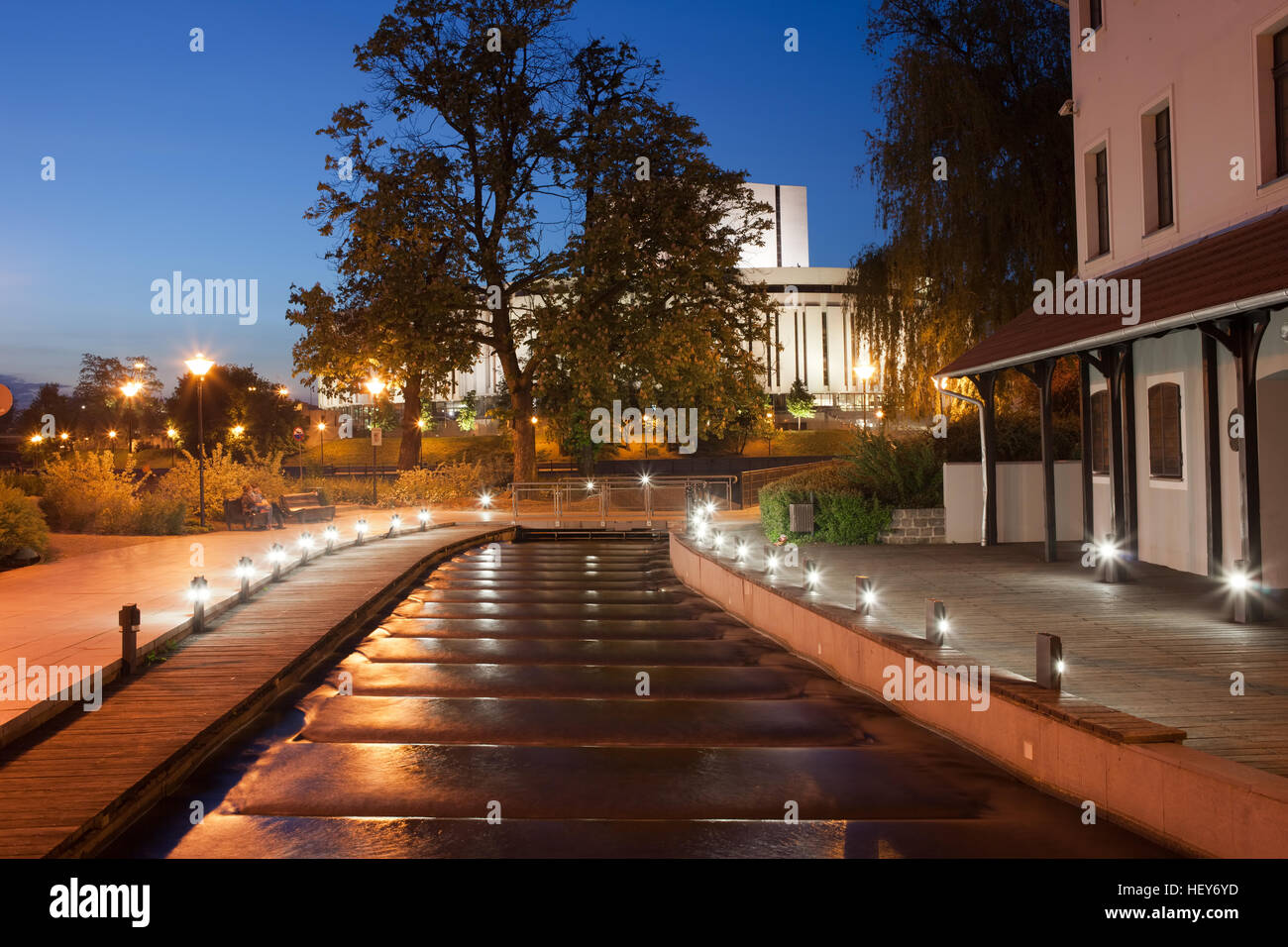 Water cascades on canal at night at Mill Island in Bydgoszcz, Poland, Europe - Stock Image