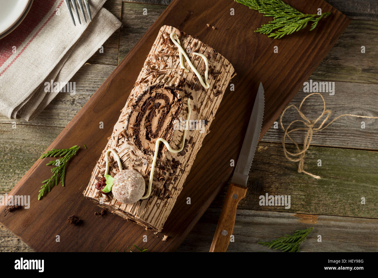 Homemade Chocolate Christmas Yule Log with Mousse and Frosting - Stock Image