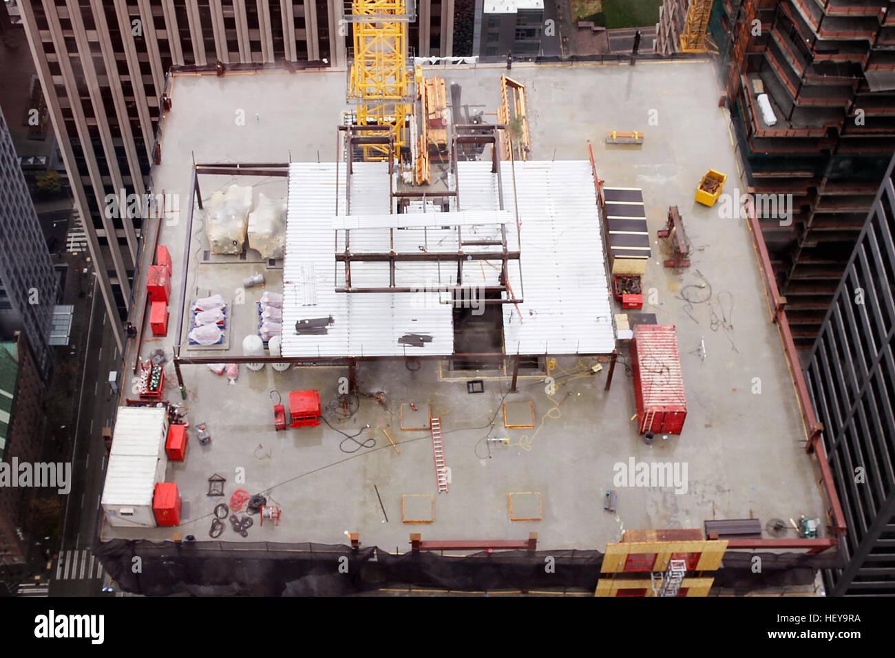 Construction at top of sky scraper. - Stock Image