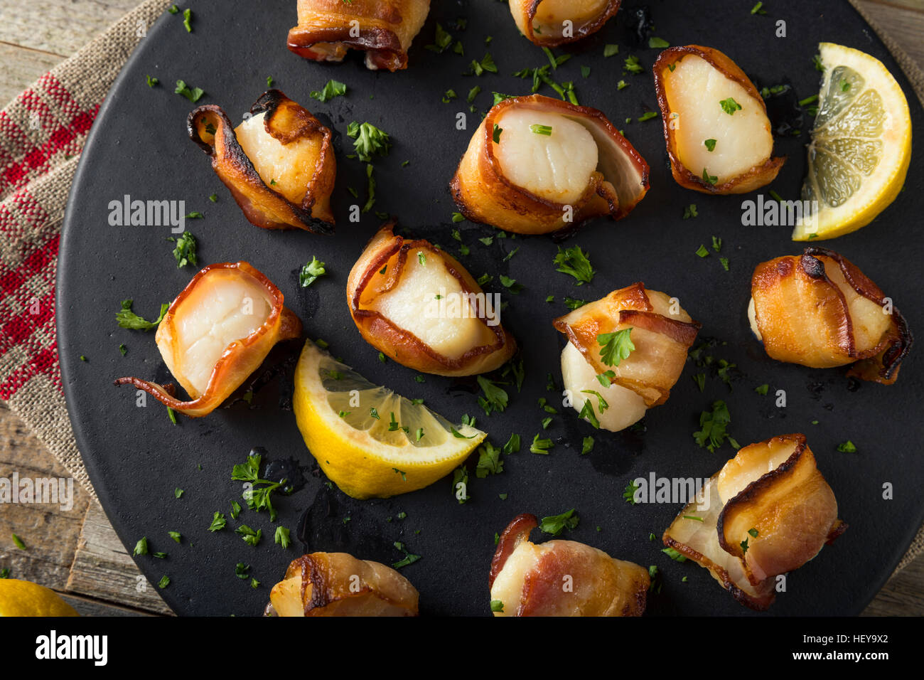 Homemade Bacon Wrapped Scallops with Salt and Pepper - Stock Image