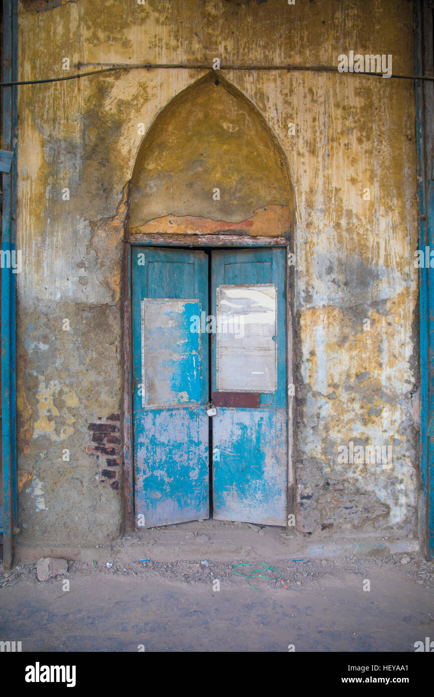 Two antique wooden doors in a yellow old and dirty wall - Stock Image - Old Antique Doors Stock Photos & Old Antique Doors Stock Images - Alamy
