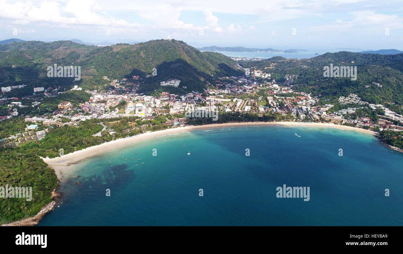 Aerial view of boats on the sea near Kata Beach with Big Buddha statue in background, Phuket, Thailand - Stock Image