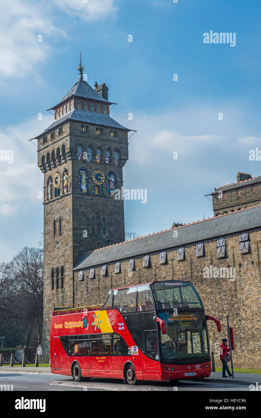 Cardiff Castle Clock Tower and City Sightseer Bus south Wales on a sunny day - Stock Image