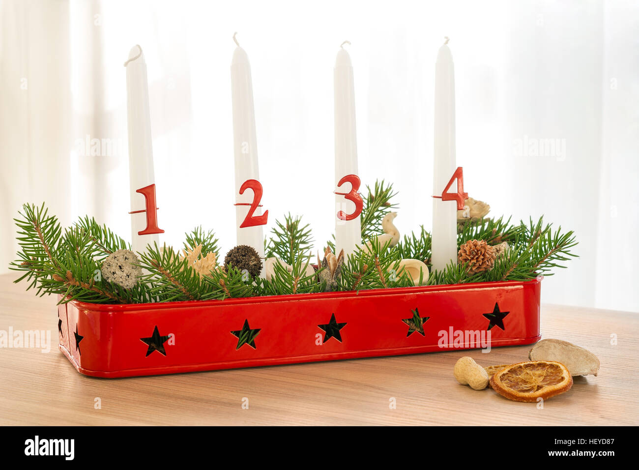 Full Christmas advent wreath with decoration on table - Stock Image
