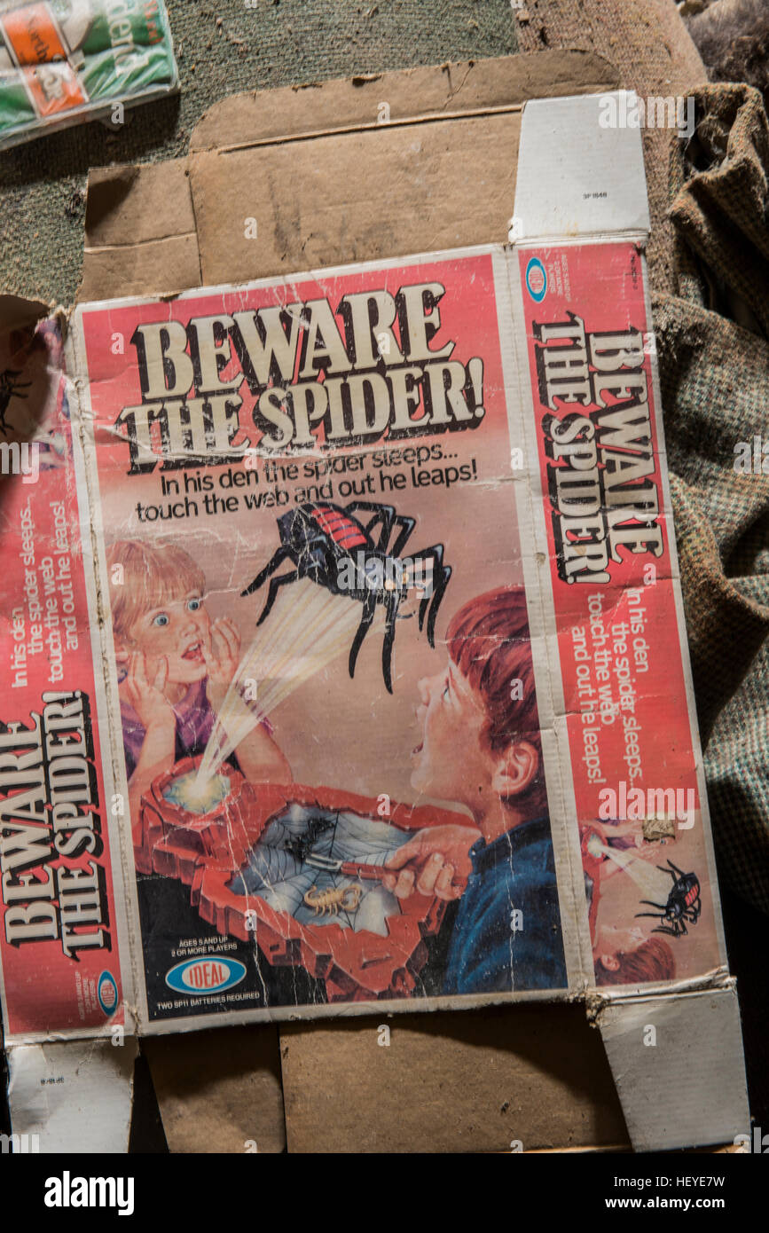 Old packaging from a child's game inside an abandoned shop and residential premises within the village of Banham, Stock Photo