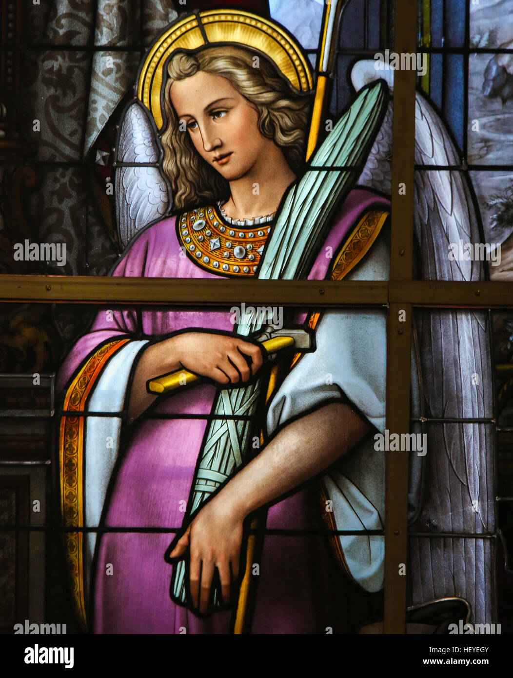 Stained Glass in Saint Nicholas Church, Ghent, Belgium, depicting an Allegory on the Suffering of Jesus, an Angel - Stock Image