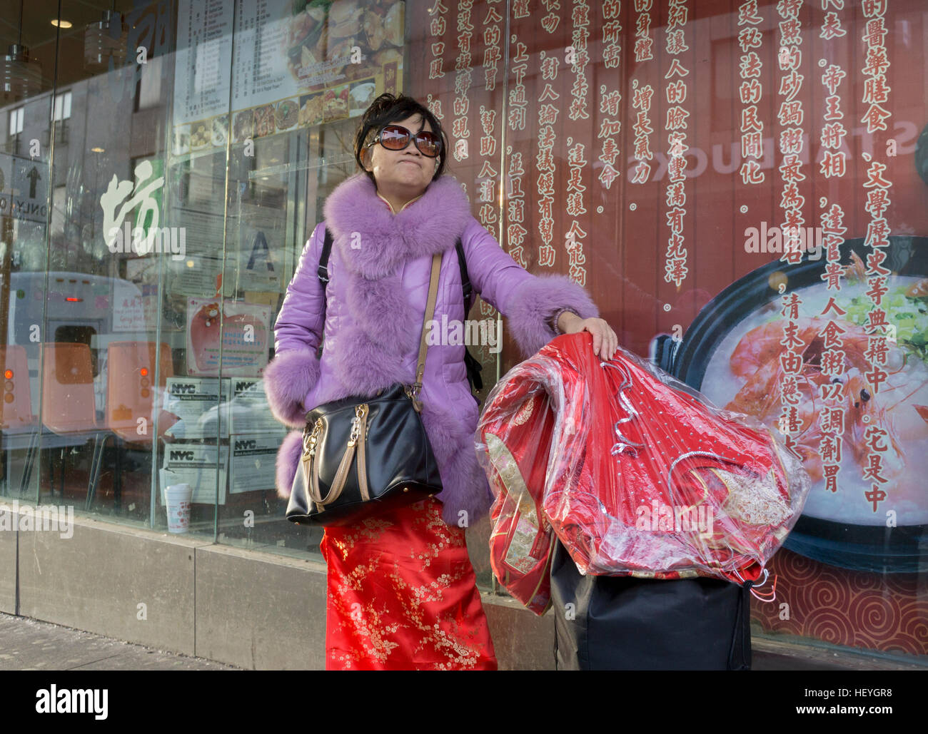 A Chinese American Woman Wearing Traditional Wedding Dress Carrying Another In Chinatown Downtown Flushing Queens New York