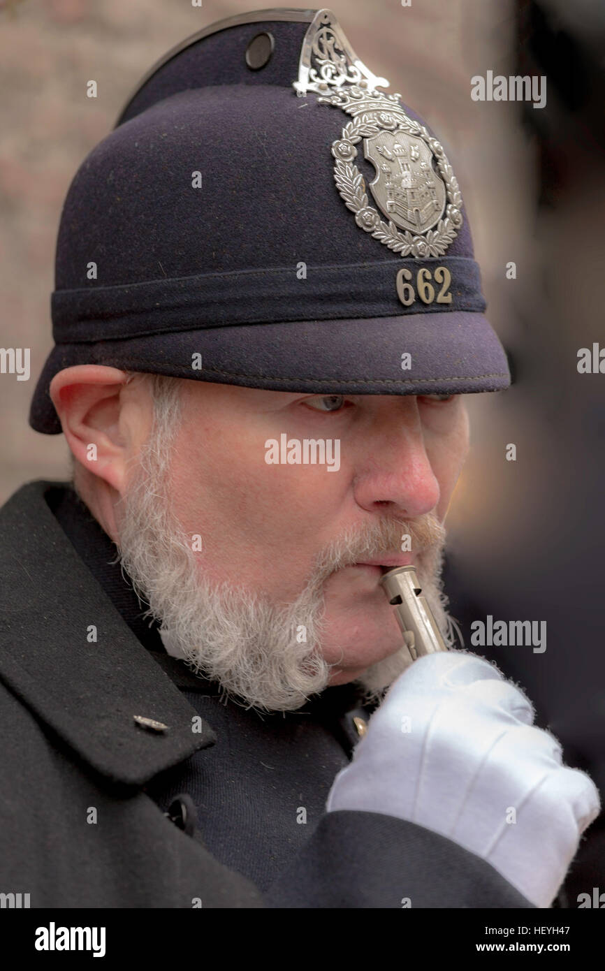 Close-up portrait of a man acting as an English Bobby at the Deventer Dickens Festival, Overijssel, The Netherlands. - Stock Image