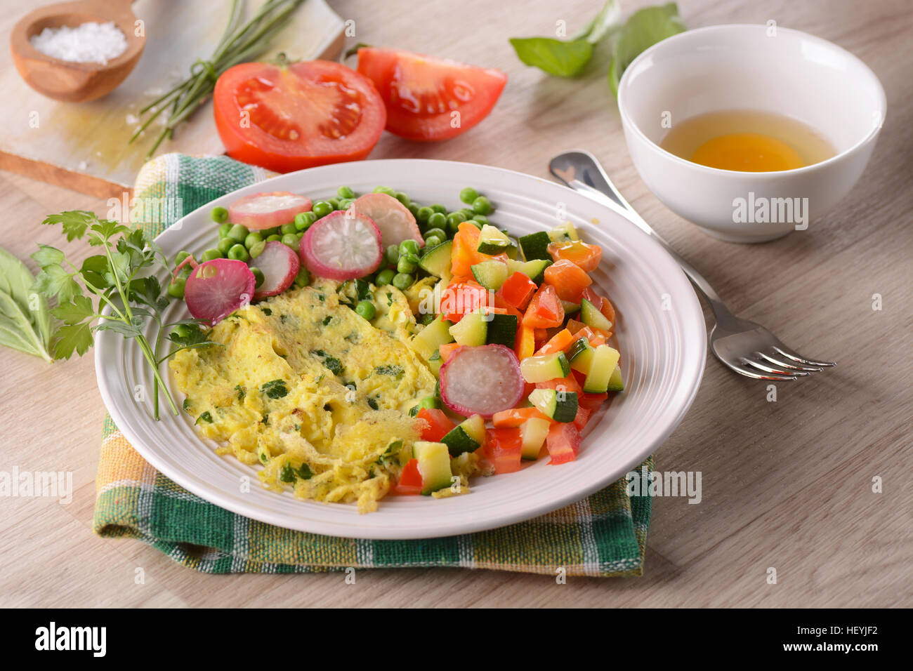 egg omelet and side dish assorted vegetables - Stock Image