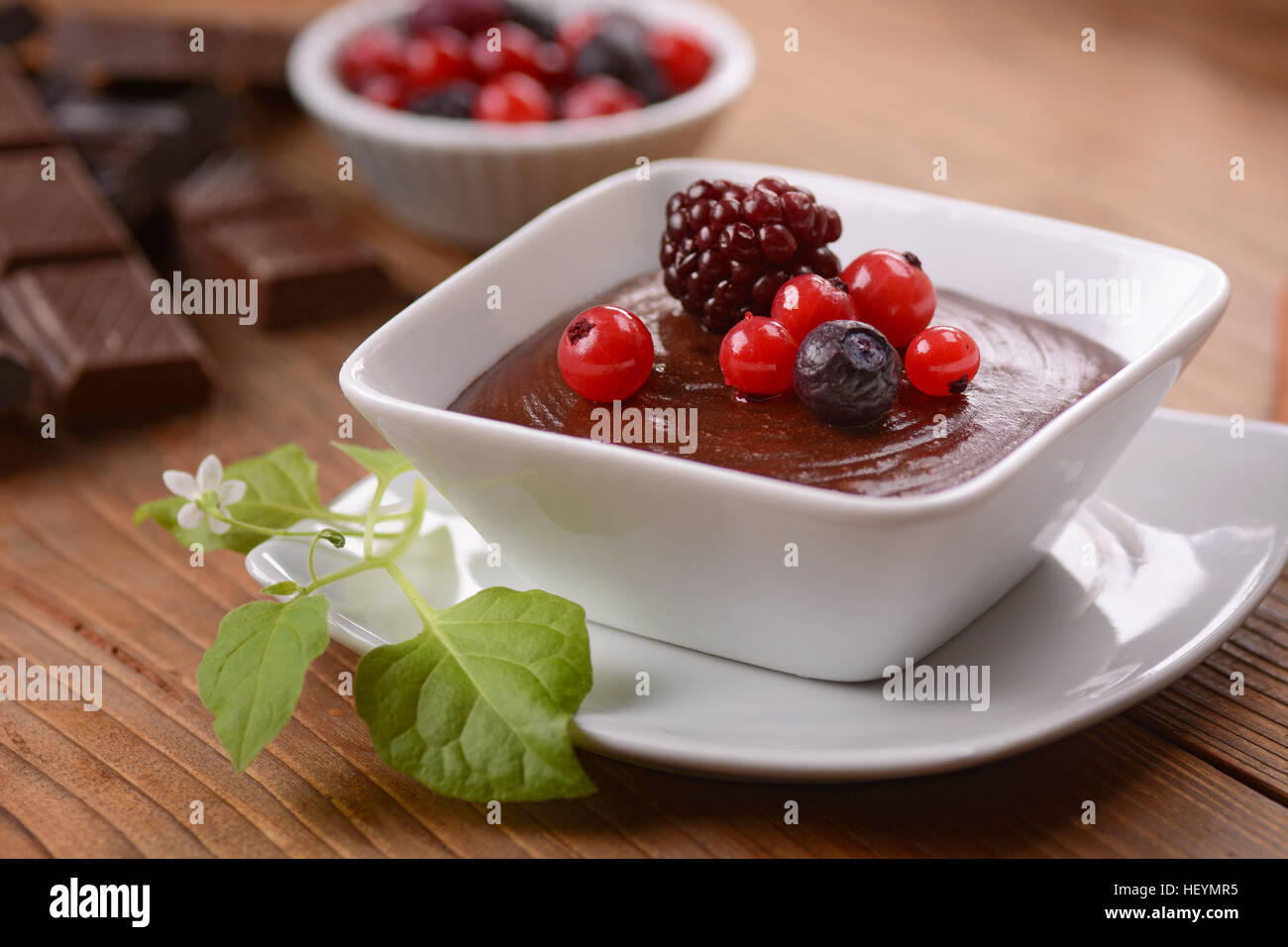 chocolate mousse decorated with berries - Stock Image