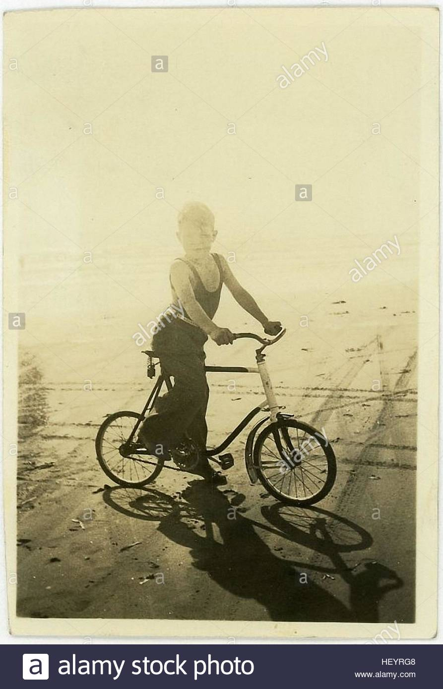 little boy on the bicycle in the vintage photography from the 30s - Stock Image