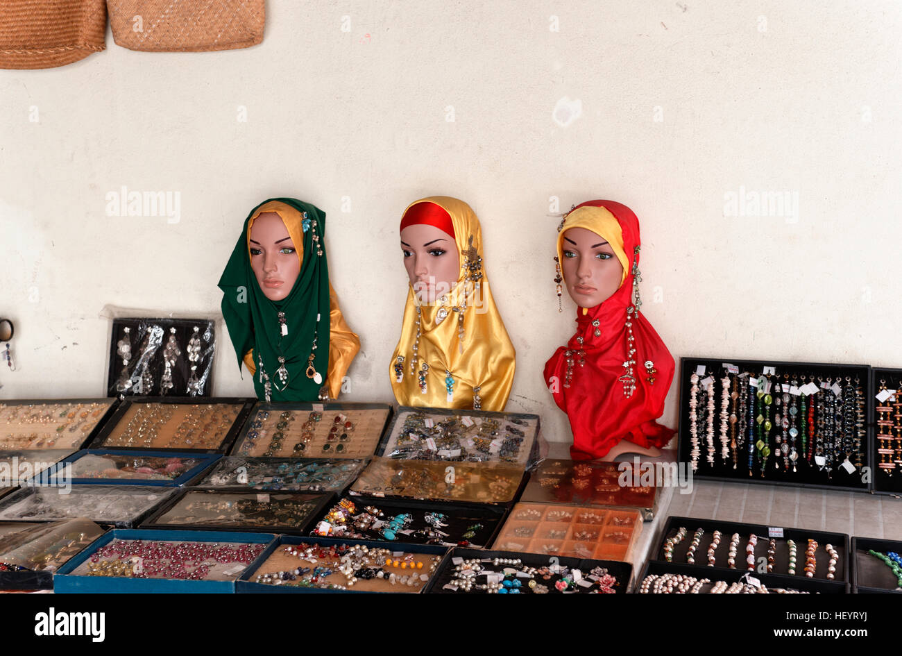 Traditional Muslim female head ware Hijabs on sale in Malaysian market stalls - Stock Image