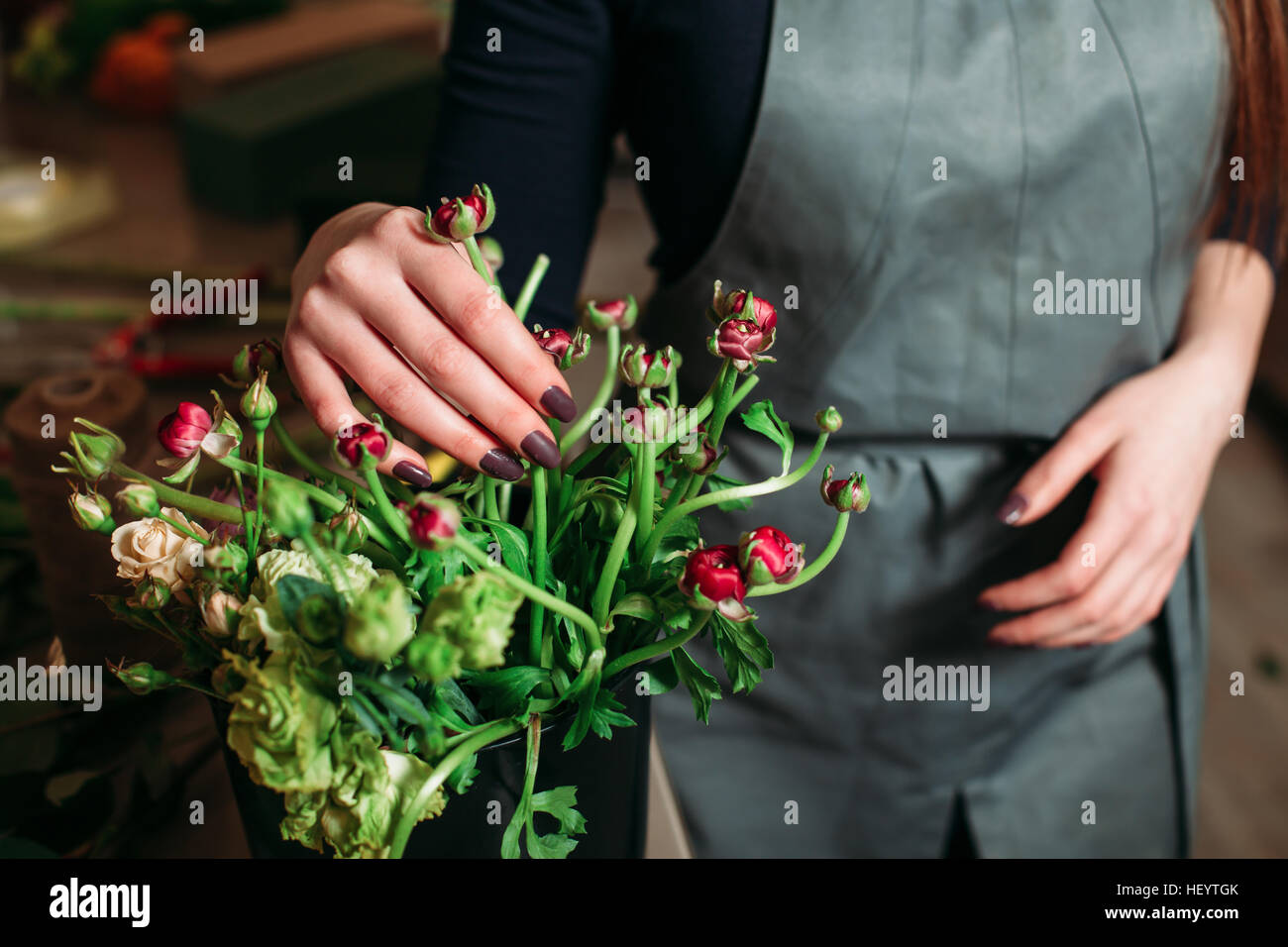 Florist with beautiful flowers. - Stock Image