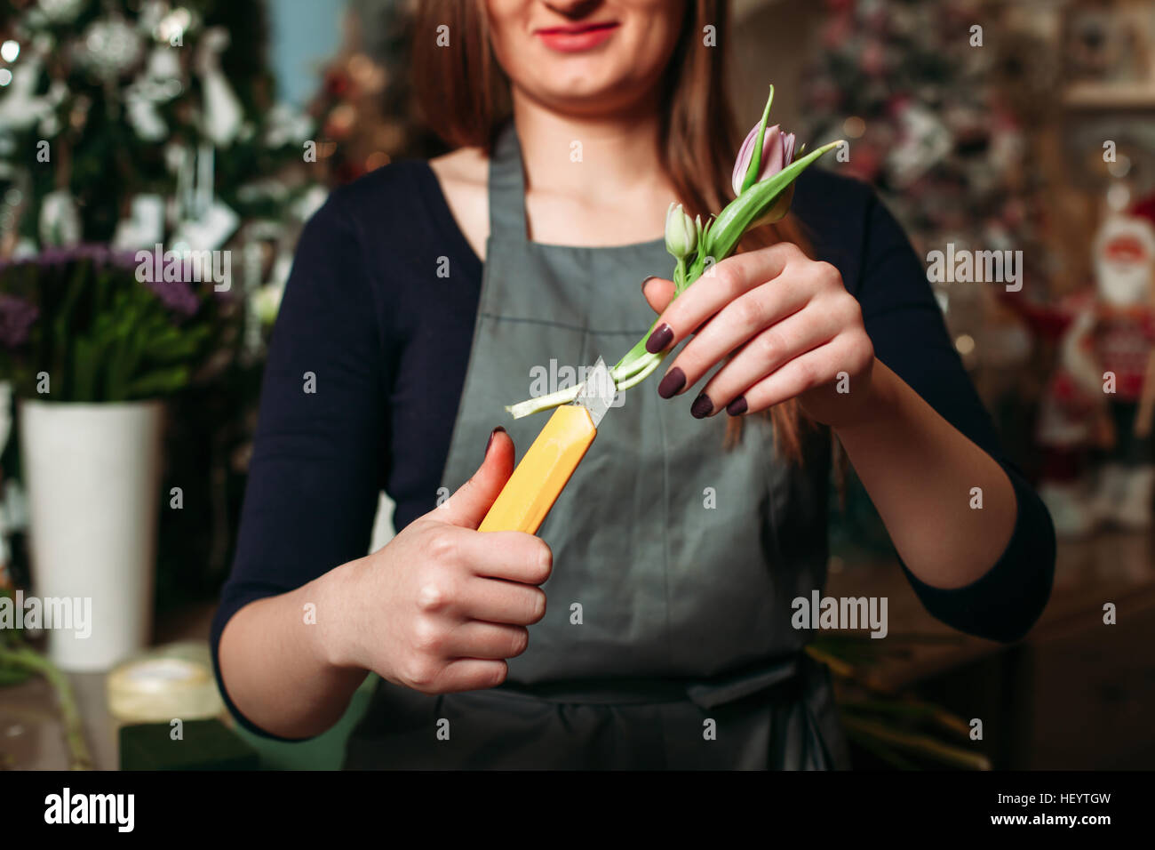 Female florist working with flowers - Stock Image