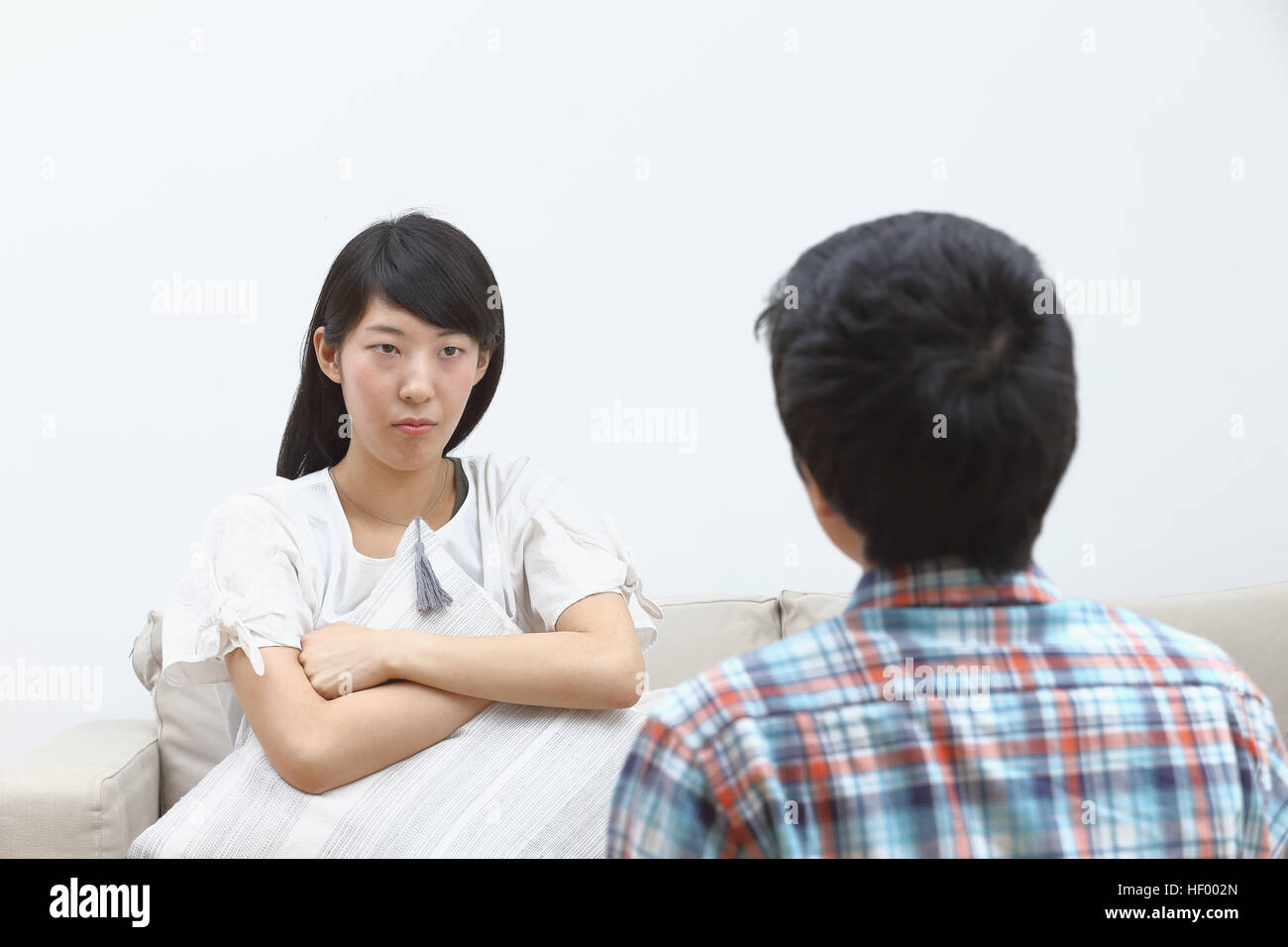 Young Japanese couple fighting Stock Photo