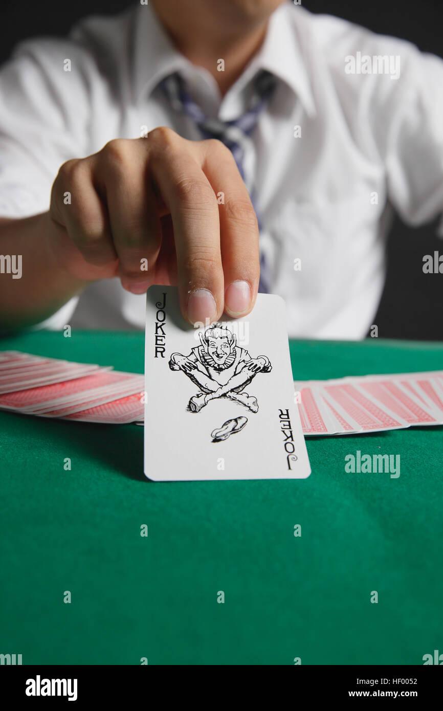 Young Japanese man gambling - Stock Image
