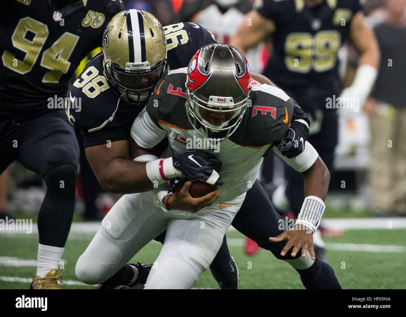 Florida, USA. 24th Dec, 2016. LOREN ELLIOTT   Times .Tampa Bay Buccaneers quarterback Jameis Winston (3) is sacked - Stock Image