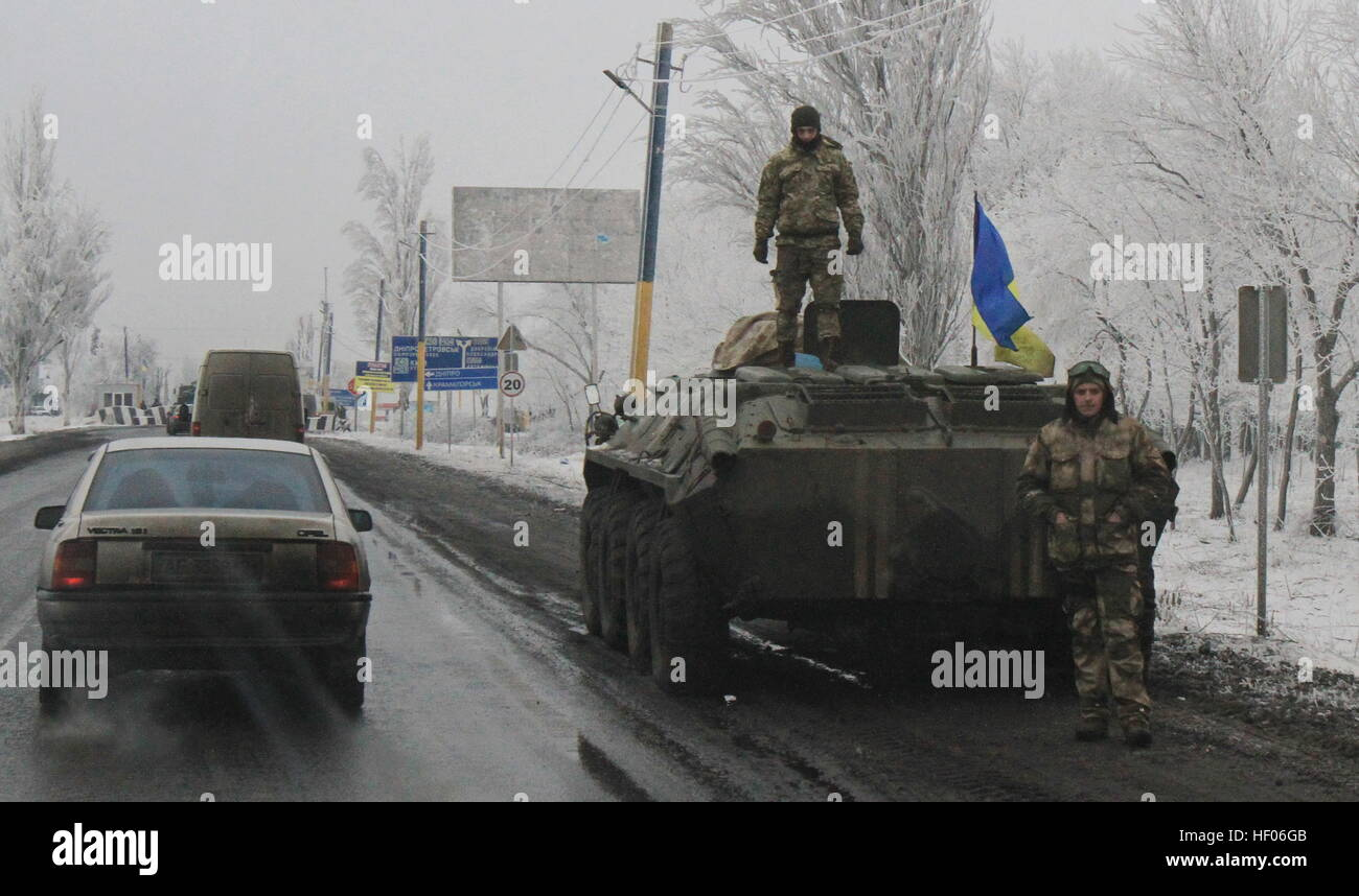 Krasnoarmeysk. 24th Dec, 2016. Photo taken on Dec. 24, 2016 shows a Ukrainian army's armored vehicle withdrawn - Stock Image