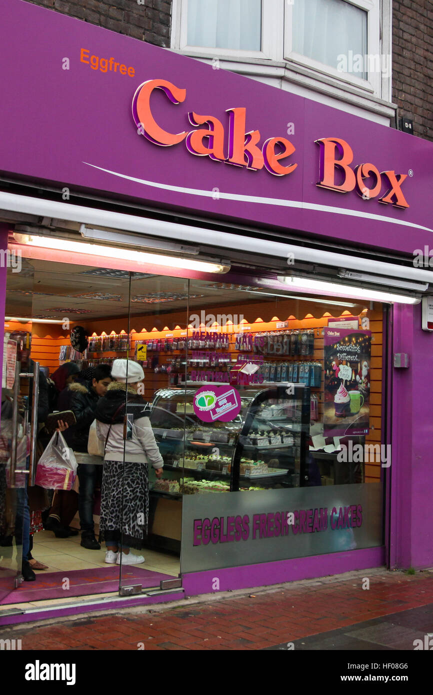 Luton, UK 25 Dec 2016 - Cake Box open as normal for business on Christmas Day in Bury Park shopping center in Luton, - Stock Image