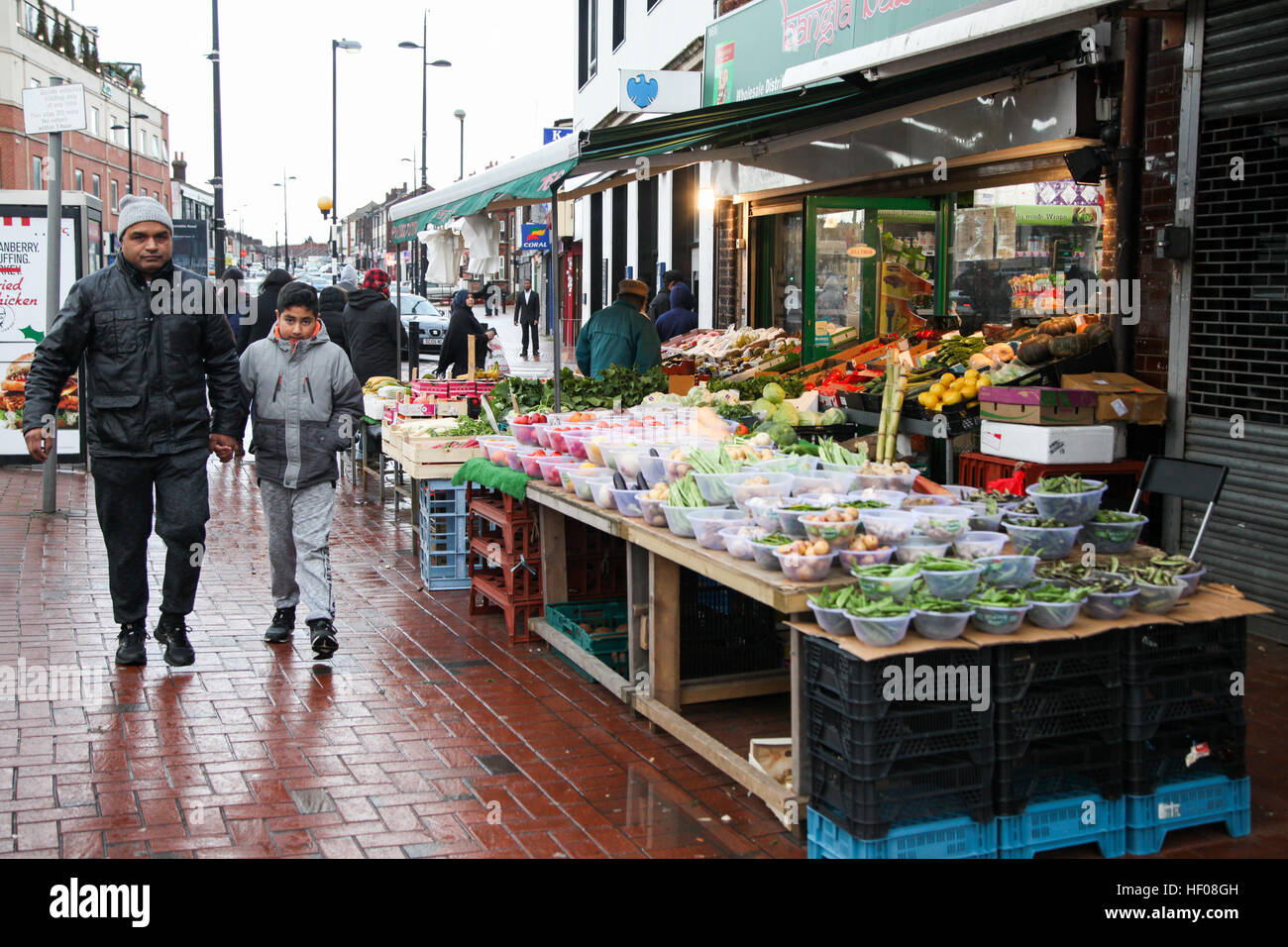 Luton, UK 25 Dec 2016 - Shops are open as normal for business on Christmas Day in Bury Park shopping center in Luton, - Stock Image