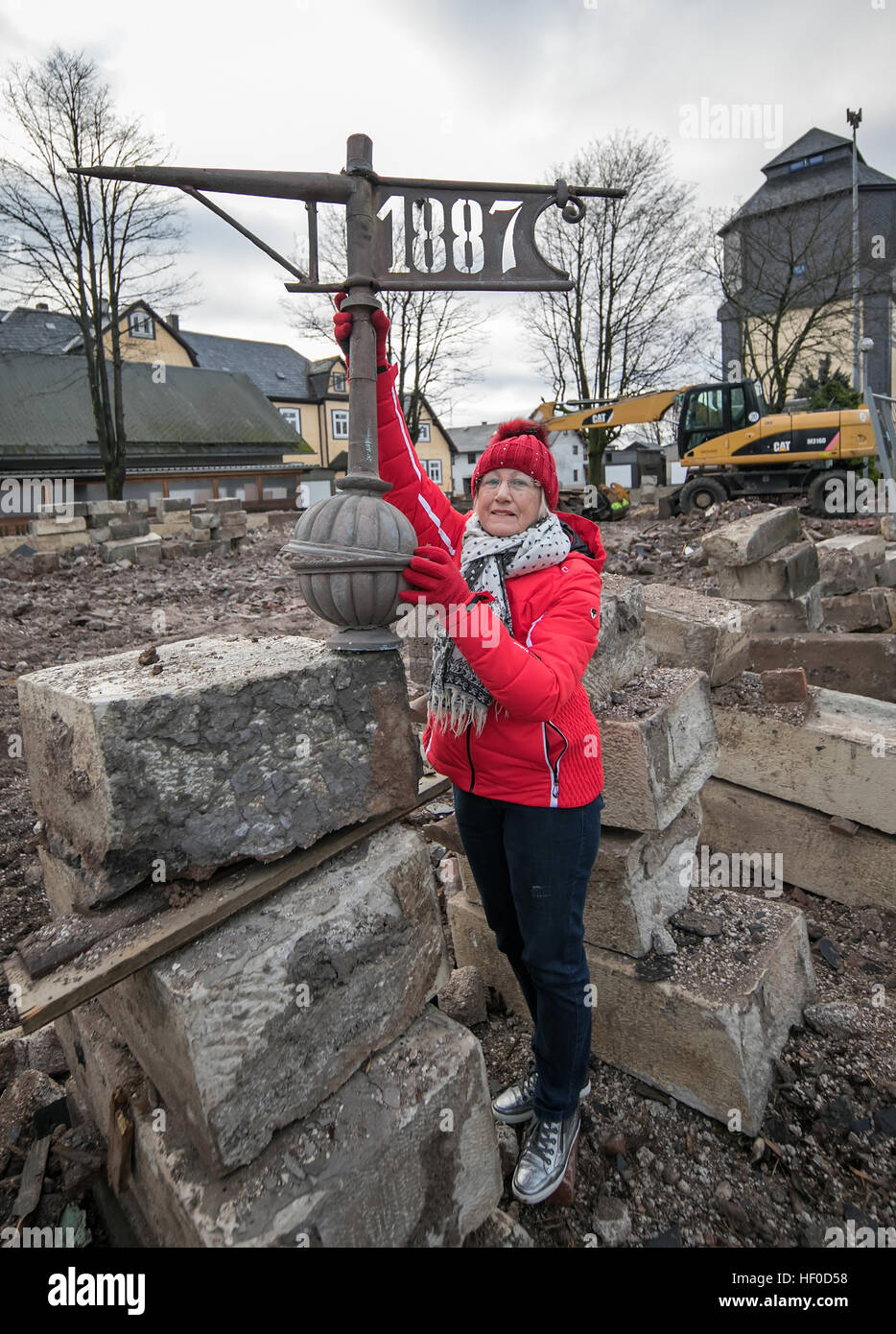 Local councillor Herma Lindenlaub with the steeple top of a demolished church in Neustadt am Rennsteig, Germany, - Stock Image