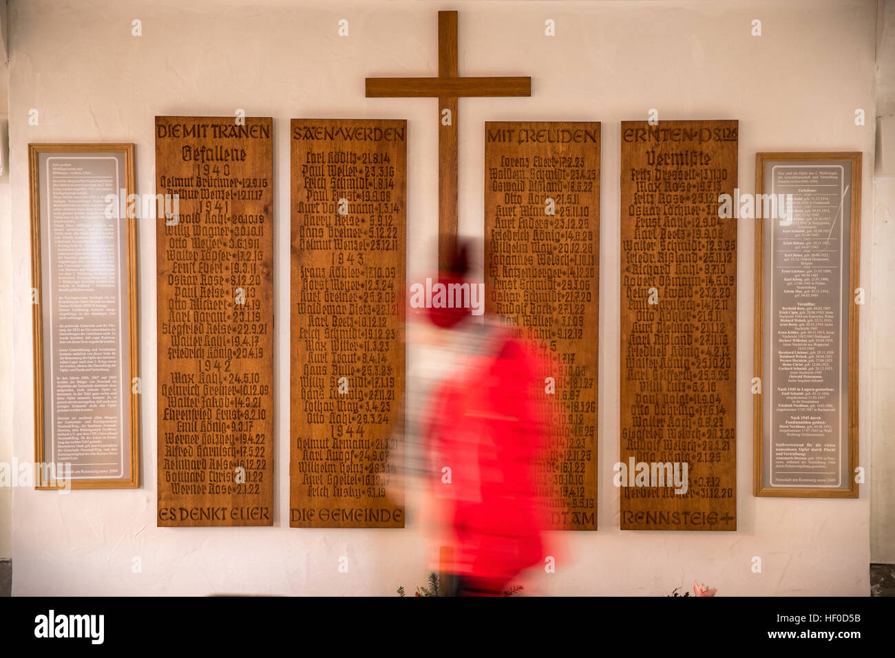 A cross and a list of the war dead salvaged from a demolished in Neustadt am Rennsteig, Germany, 15 December 2016. - Stock Image