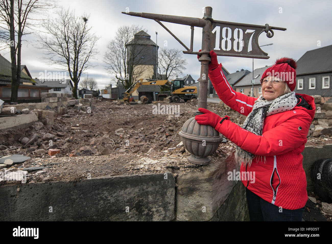 Local councillor Herma Lindenlaub with the steeple top of a demolished in Neustadt am Rennsteig, Germany, 15 December - Stock Image