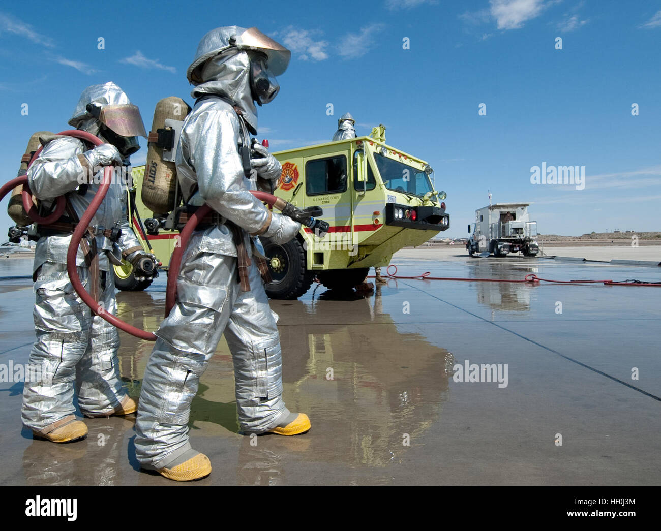 us marine firefighters with marine corps air station mcas yuma aircraft rescue and firefighting team stand ready to assist their counterparts from