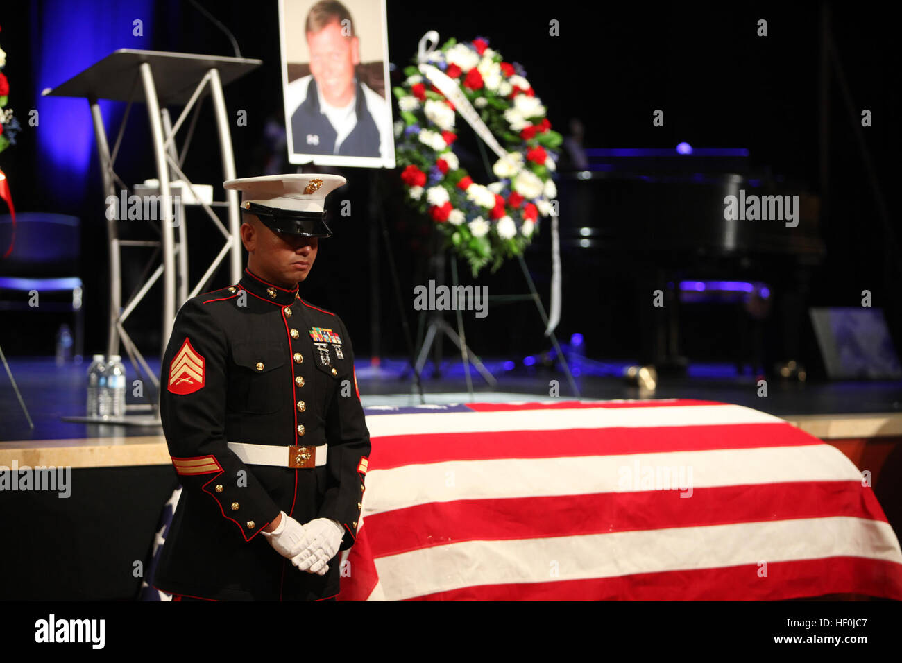 During the memorial ceremony for Officer Jeremy Henwood, Marines and police officers stand guard over his casket - Stock Image