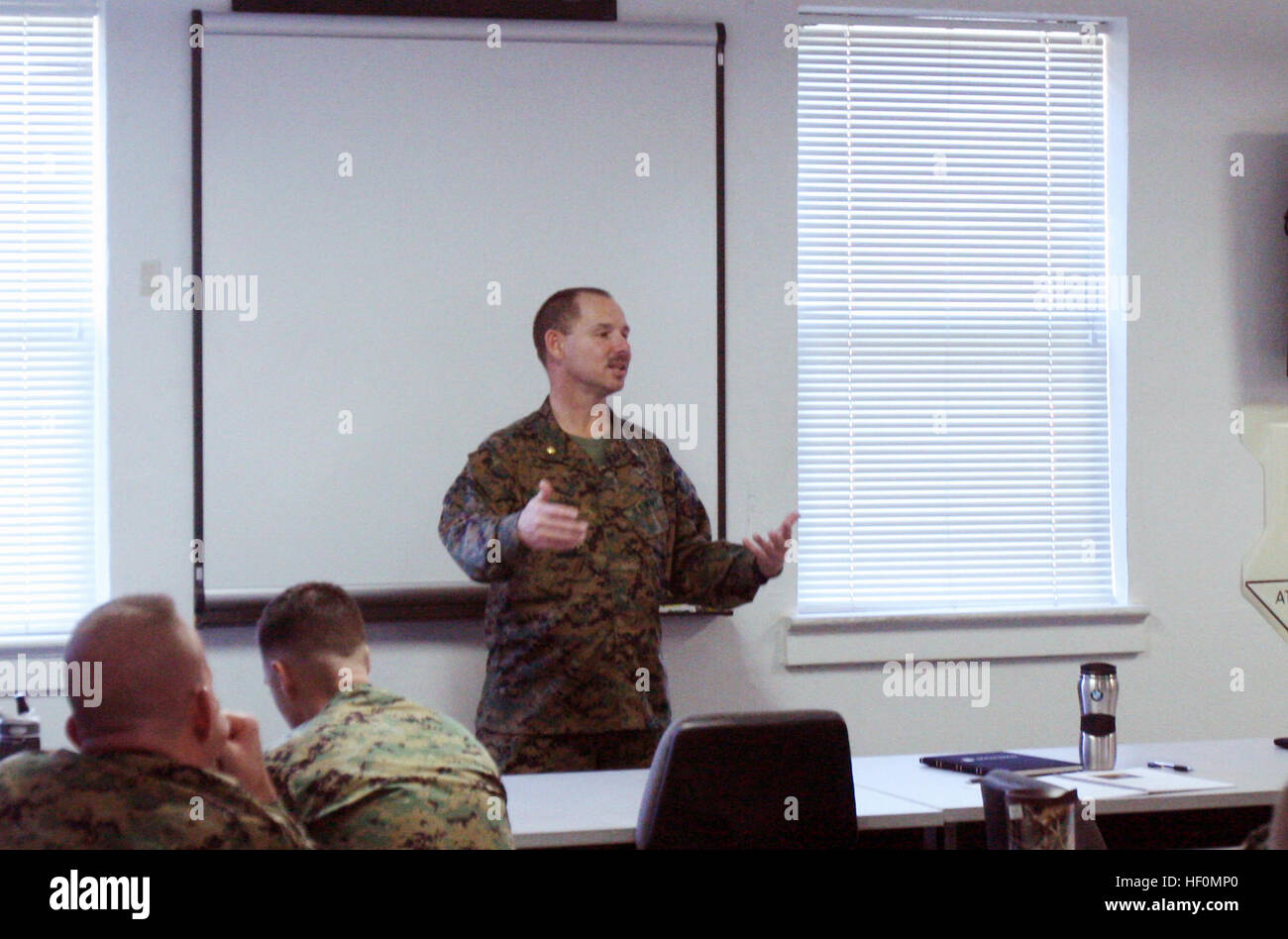 Lt. Cmdr. Tim Johns, the chaplain for Combat Logistics Regiment 27, 2nd Marine Logistics Group, conducts an Operational - Stock Image
