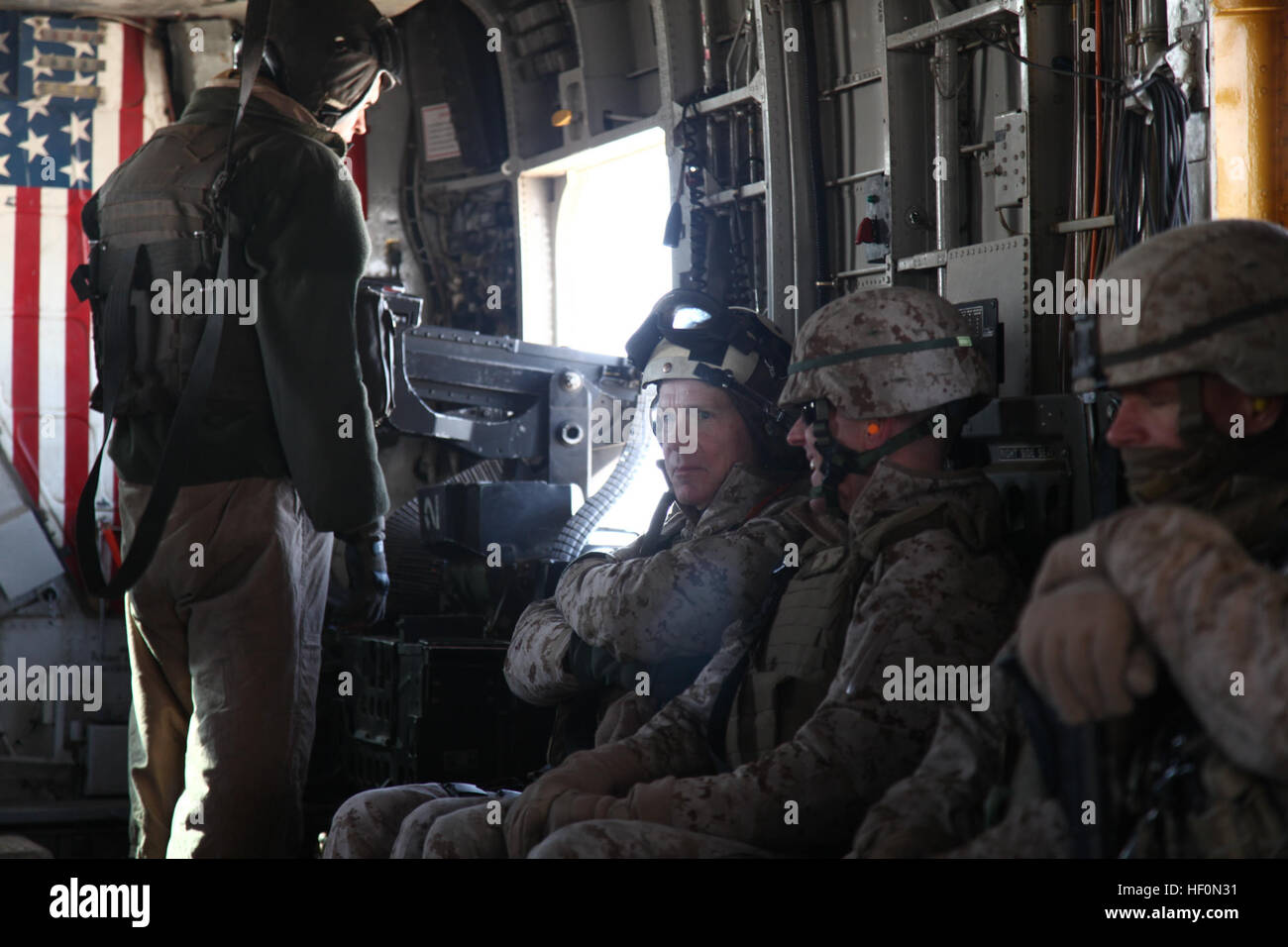 U.S. Marine Corps General James F. Amos, Commandant of the Marine Corps, travels on a CH-53 Delta helicopter in Stock Photo