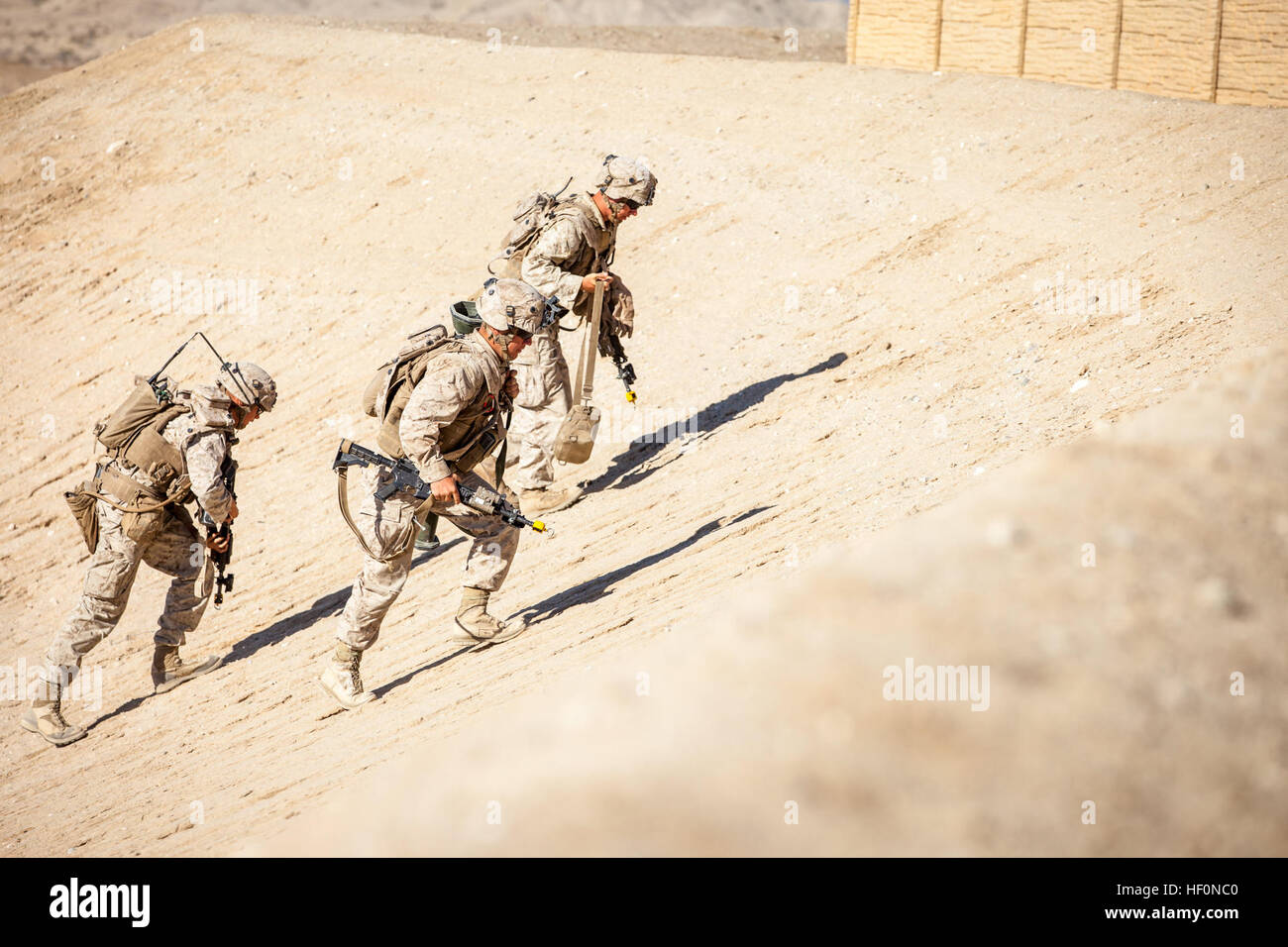Marines with 3rd Battalion, 7th Marine Regiment, charge a hill on Range 220, a Military Operations on Urbanized - Stock Image