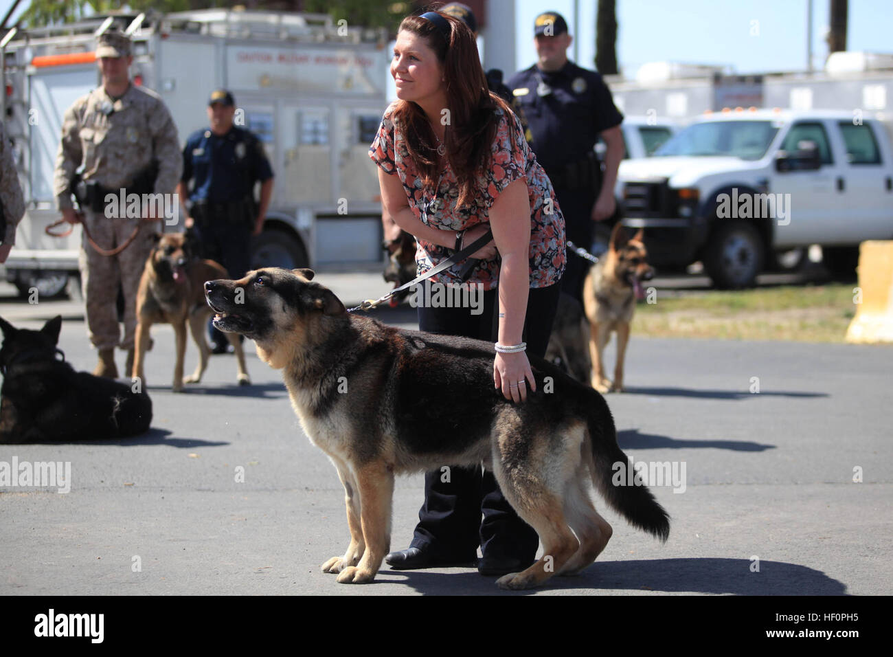 Former Marine Cpl  Megan Leavey pets Military Working Dog Rex during