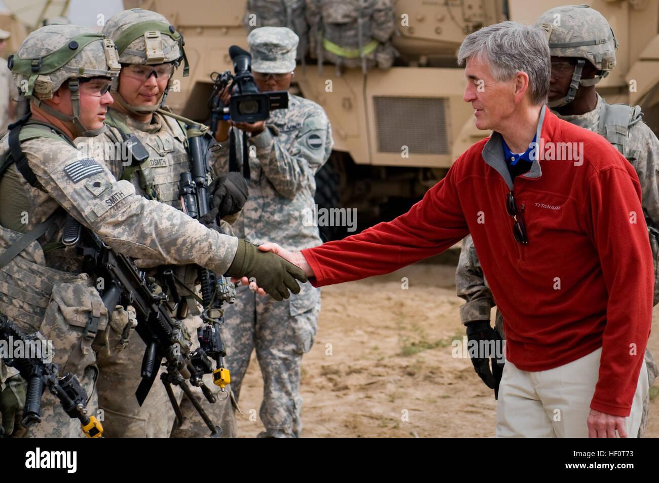 Secretary John McHugh, the 21st secretary of the Army, shakes the hand of a 2nd Heavy Brigade Combat Team, 1st Armored Stock Photo
