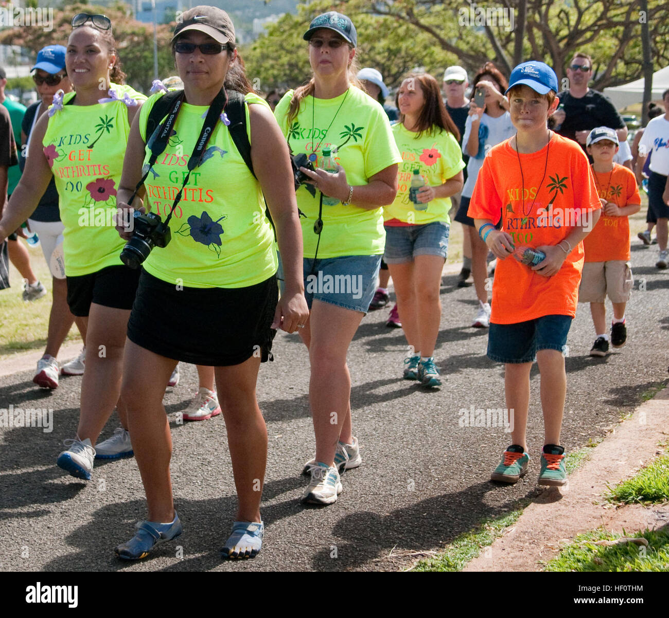 The team members of 'Team Ty' walk the one-mile route during the 2012 Hawaii Arthritis Walk at Kakaako Beach - Stock Image