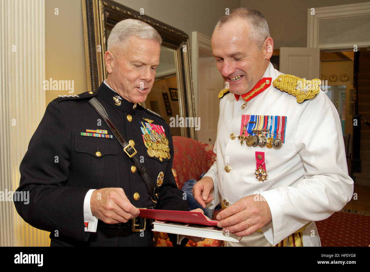 Commandant of the U.S. Marine Corps Gen. James F. Amos, left, speaks with Commandant General of the British Royal Stock Photo
