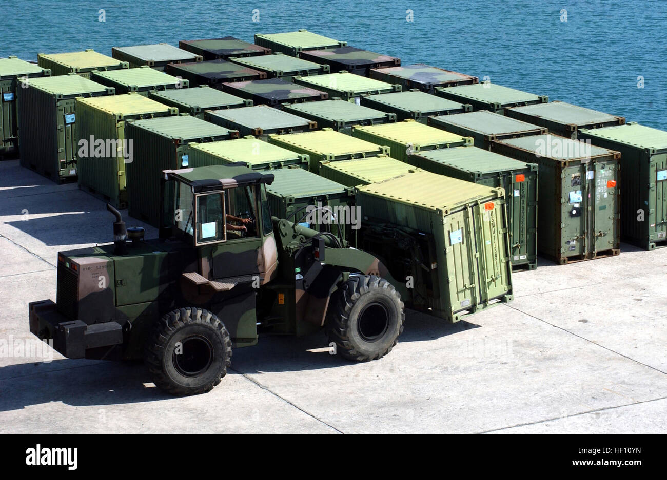 051010-M-0596N-001 Kin Red Port, Okinawa, Japan (Oct. 10, 2005) - A tractor moves a quadcon container at Kin Red - Stock Image