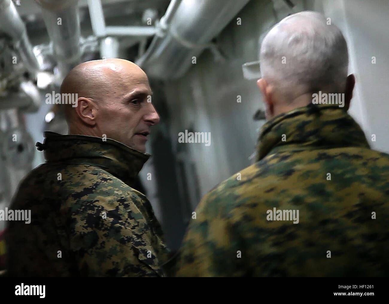 Col. Matthew G. St. Clair, 26th Marine Expeditionary Unit commanding officer, talks with General James F. Amos, Stock Photo