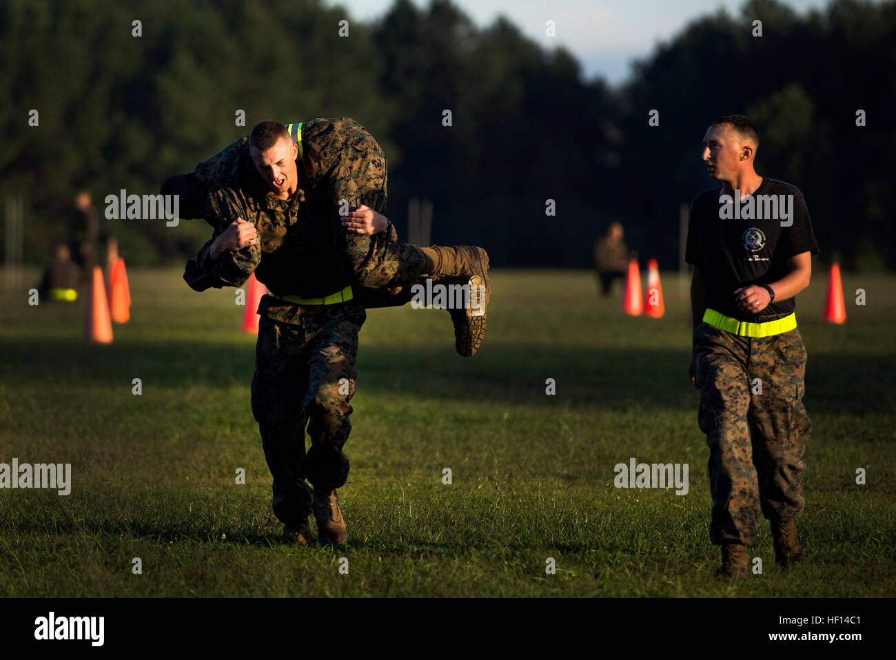 A student at the Infantry Training Battalion buddy carries another student during the maneuver-under-fire portion - Stock Image
